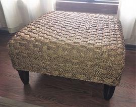 Room & Board woven wicker ottoman.