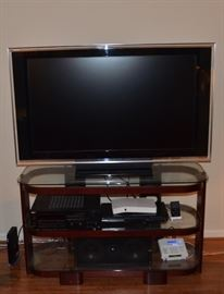 Sony XBR TV and Bell'Oggetti TV stand (sold separately; other items pictured not for sale)