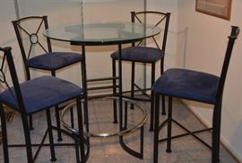Tall dining table set with four chairs