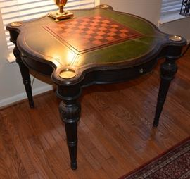 Game table.  Chess board flips over to match green leather.