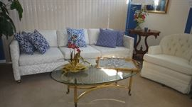 Custom Upholstered contemporary sofa, Custom Designed pillows, Brass and Glass top table,