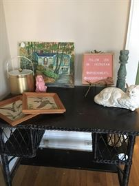 chippy black wood and wicker desk