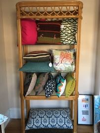 tons of pillows and great storage pieces like this bamboo and glass shelf!
