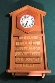 WOOD CALENDAR CLOCK  http://www.ctonlineauctions.com/detail.asp?id=695826