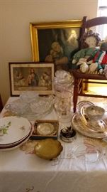 Religious themed artwork, antique dishes, antique child's chair