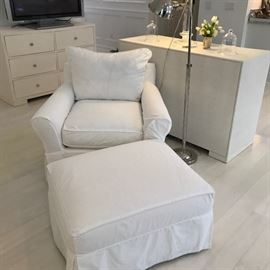 Ecru upholster chair and ottoman with white slip covers. Slip covers are included with the chair & ottoman.
