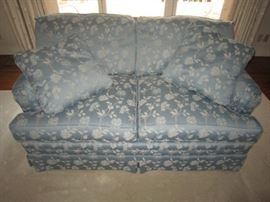 One of a pair of loveseats