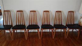 "Set of six Niels Koefed ""Eva"" teak dining chairs with original black vinyl seats. 1960's"
