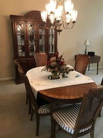 Nice pecan table with 8 chairs, 2 leafs, and table pads