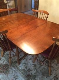 Ethan Allen table with leaf and 8 chairs...great condition