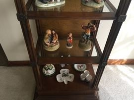 Porcelain  figurines/ curio unit