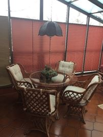 nice rattan glass top table and four chairs - in great shape