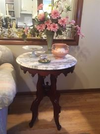 We have a set of 2 of these tables and coffee table to match plus 2 matching short plant stand/chair side tables!