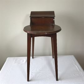 Sew Delightful tiny mahogany sewing table    http://www.ctonlineauctions.com/detail.asp?id=695236