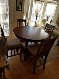 beautiful round pub style table with inlaid wood and 6 high padded chairs. Only 4 chairs pictured due to space.