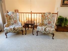 A matching pair of beautifully upholstered wing back chairs