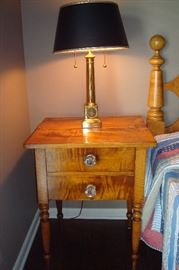 Tiger maple stand with 1923 Harvard University brass lamp.