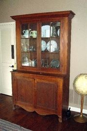 1875 period pine kitchen cupboard with 12 glass panes and two doors below.