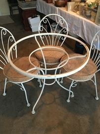 Bistro table and chairs; 3 chairs with upholstered cushions; glass top is missing.