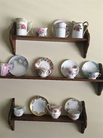 Shelves with decorative tea cups/saucers