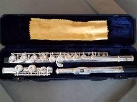 Flute. Guitar cases (not shown)