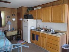 """3rd floor (penthouse) kitchen; Hotpoint fridge 28"""" wide x  27"""" deep x 61"""" tall"""