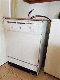 GE portable dishwasher with faux wood counter-top. Excellent condition.