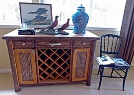 Was $850 will now be $425                                                           Copper top wine/buffet with Elk handle  48 wide x 33 1/2 high x 21 deep