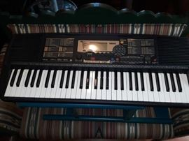 Yamaha PSR-225 electronic keyboard. Works very well. Portable, can run on batteries.