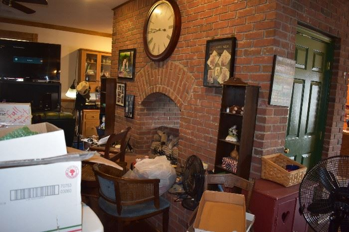 Awesome Brick Fireplace accented with Display Cabinets, Pictures and Prints, and more!