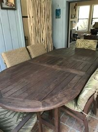 Teak outdoor table with 6 chairs total, 2 with arms. All have cushions!