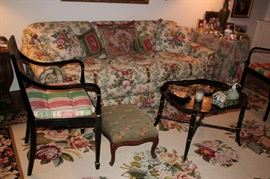 Living Room with Sofa, Rug, Foot Stool,  Pair of Side Chairs and Bric-A-Brac