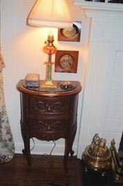 Demi-Lune Chest with Art, Table Lamp and other Decorative Items