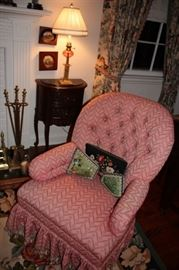 Upholstered Easy Chair, Fireplace Tools, Demi-Lune Chest with Art, Table Lamp and other Decorative Items