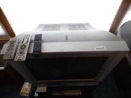 Samsung TV on stand- DVD/VHS player- DVDs/ VHS tap ...