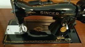 Singer sewing machine with beautiful cabinet.