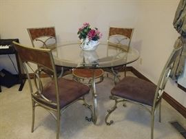 iron/glass top table - 4 chairs