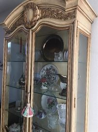 French provincial lighted China display cabinet with glass doors and cabinet below.
