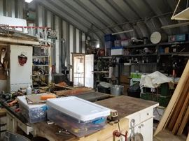 table saws, routers, blowers, drills, joiners, planner, scrap wood, work benches, caster wheels, hand tools, shop rags, vises