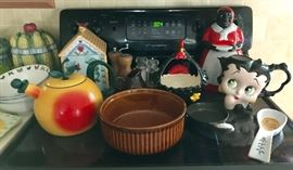 Cookie Jars (More than Pictured), Peach Tea Pot, Betty Boop Pitcher, Rooster Ceramic Basket, Cast Iron  & More