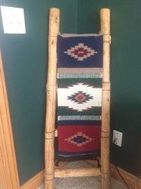 American Indian rug and ladder