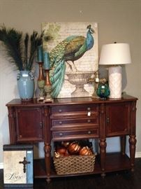 Entry piece or buffet with peacock accessories