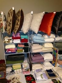 Assorted bed linens and pillows