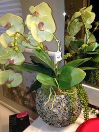 Artificial orchids in unique vase