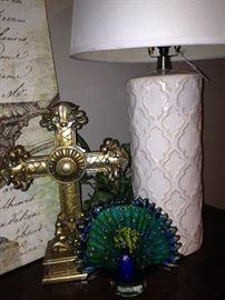 Cross, lamp, and peacock