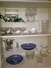 Glass serving pieces; blue & white plates
