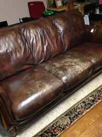 Leather sofa (as is) has matching love seat.