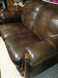 Leather loveseat (as is) has matching sofa.