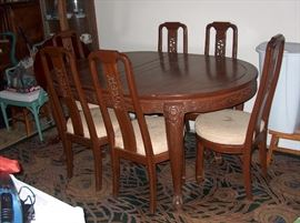 teak dining table and chairs; have several rugs also