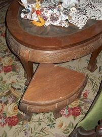coffee table with carved inset & glass top with 6 stools that fit underneath; over 40 years old!teak wood